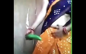 Desi aunty playing relating to cucumber